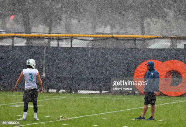 Miami Dolphins special team coach Darren Rizzi trains with kicker Andrew Franks in the rain during OTAs on Monday June 5 2017 at the Miami Dolphins...