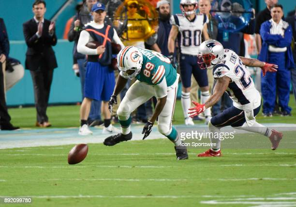 Miami Dolphins tight end Julius Thomas recovers his own fumble during an NFL football game between the New England Patriots and the Miami Dolphins on...