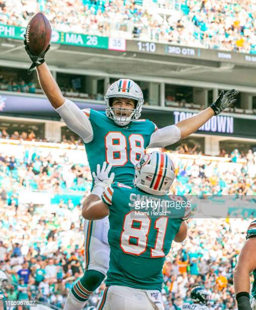 Miami Dolphins tight end Mike Gesicki and Miami Dolphins tight end Durham Smythe celebrate after scoring in the third quarter as the Miami Dolphins...