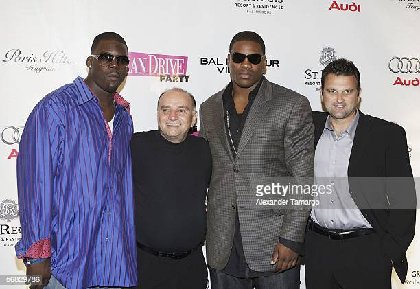 Miami Dolphins tight end Randy McMichael, Jerry Powers, Chicago Bears defensive end Adewale Ogunleye and sports agent Drew Rosenhaus make an...