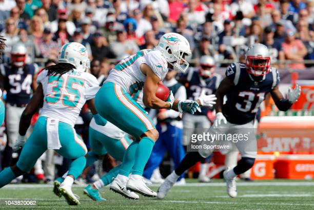 Miami Dolphins wide receiver Danny Amendola carries the ball during a game between the New England Patriots and the Miami Dolphins on September 30 at...