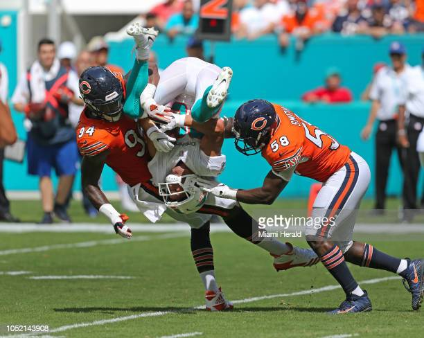 Miami Dolphins wide receiver Danny Amendola is tackled by Chicago Bears linebackers Leonard Floyd and Roquan Smith during the first quarter on Sunday...