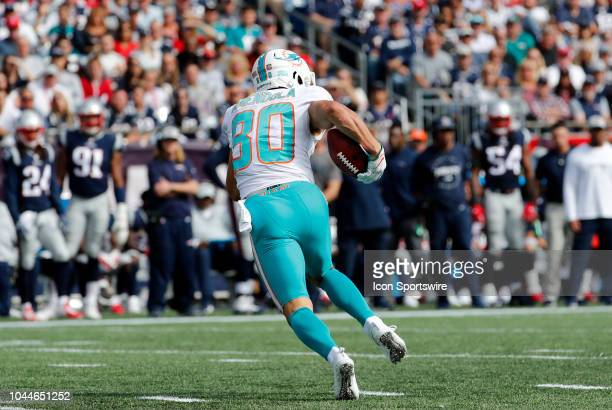 Miami Dolphins wide receiver Danny Amendola returns a punt during a game between the New England Patriots and the Miami Dolphins on September 30 at...