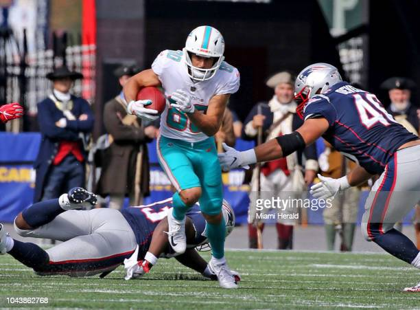 Miami Dolphins wide receiver Danny Amendola runs the ball against the New England Patriots in the second quarter on Sunday Sept 30 2018 at Gillette...