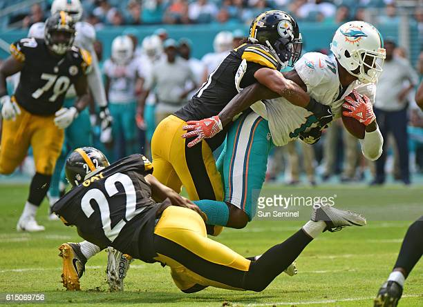 Miami Dolphins wide receiver DeVante Parker catches a pass over the middle as Pittsburgh Steelers cornerback Ross Cockrell makes the tackle in the...
