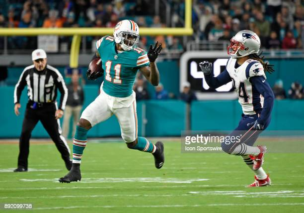 Miami Dolphins wide receiver DeVante Parker is pursued by New England defensive back Stephon Gilmore during an NFL football game between the New...