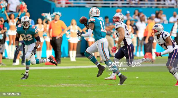 Miami Dolphins wide receiver DeVante Parker pitches to Miami Dolphins running back Kenyan Drake before scoring against the New England Patriots in...