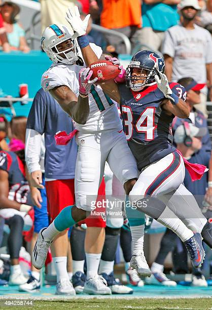 Miami Dolphins wide receiver DeVante Parker pulls in a first down reception as Houston Texans cornerback AJ Bouye defends during the second quarter...