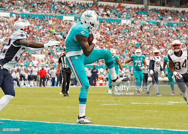 Miami Dolphins wide receiver DeVante Parker scores as New England Patriots free safety Devin McCourty fails to defend during the second quarter on...