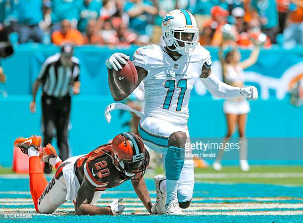 Miami Dolphins wide receiver DeVante Parker scores in the first quarter as Cleveland Browns cornerback Briean BoddyCalhoun fails to defend at...