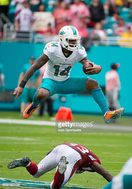 Miami Dolphins Wide Receiver Jarvis Landry jumps over Arizona Cardinals Running Back Kerwynn Williams as he runs with ball on a punt return during...