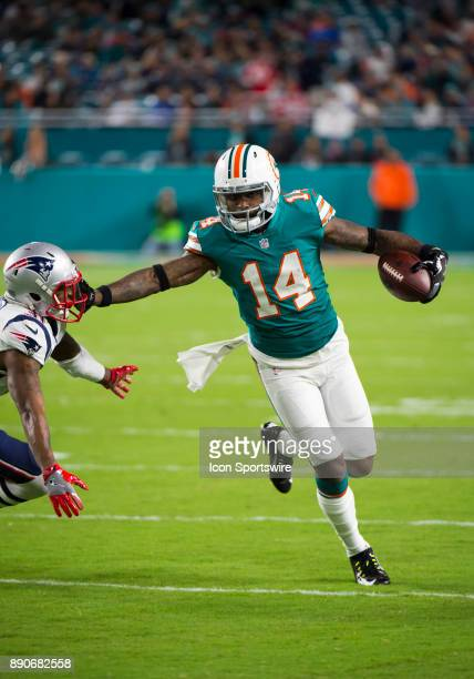 Miami Dolphins Wide Receiver Jarvis Landry stiff arms New England Patriots Cornerback Jonathan Jones as he runs with the ball during the NFL football...