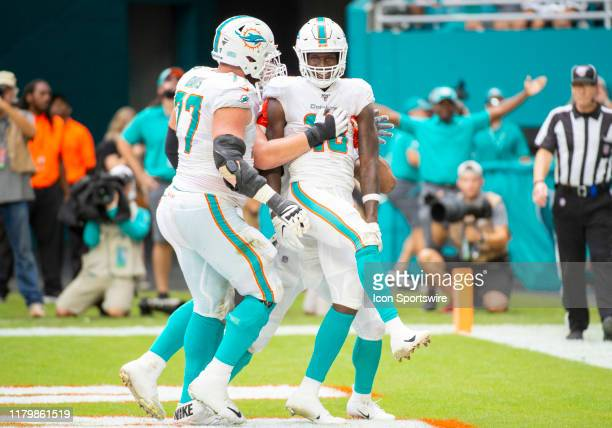 Miami Dolphins Wide Receiver Preston Williams smiles as he celebrates scoring a touchdown with Miami Dolphins Offensive Tackle Jesse Davis during the...