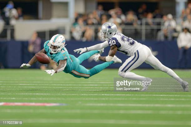 Miami Dolphins Wide Receiver Preston Williams stretches for a pass with Dallas Cowboys Cornerback Anthony Brown defending during the game between the...