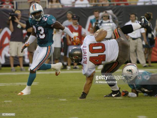 Miami Dolpins cornerback Patrick Surtain watches Tampa Bay Buccaneers fullback Mike Alstott tumble to the turf at Raymond James Stadium in a...