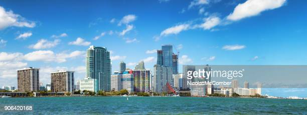 miami downtown brickell skyline sunny day extended panorama - downtown miami stock pictures, royalty-free photos & images
