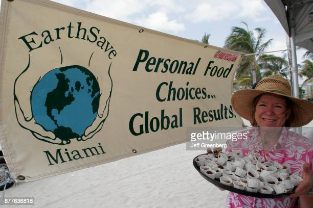 Miami Earth Day Expo Woman with tray of organic snacks cups of fudge