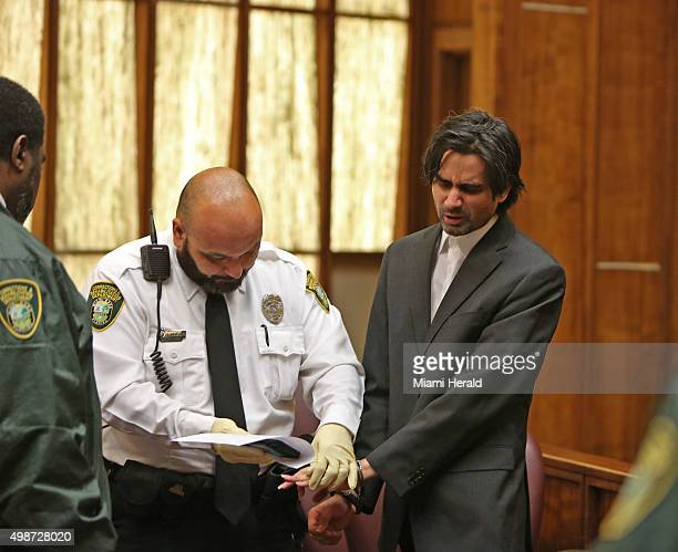 Miami Facebook killer Derek Medina is finger printed by corrections officer Juan DeJesus after he was found guilty of seconddegree murder Wednesday...