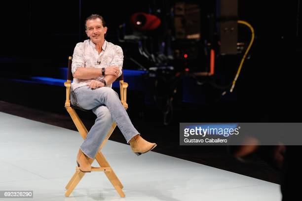 Miami Fashion Week Honorary President Antonio Banderas answers questions backstage at the Agatha Ruiz De La Prada Show during Miami Fashion Week at...