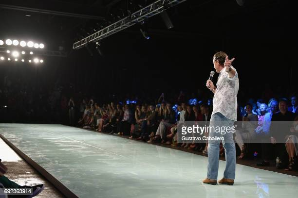 Miami Fashion Week Honorary President Antonio Banderas speaks at the Angel Sanchez Show during Miami Fashion Week at Ice Palace Film Studios on June...