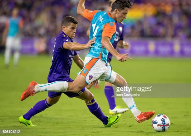Miami FC midfielder Robert Baggio Kcira clears a ball vs Orlando City SC defender Rafael Ramos During the Lamar Hunt US Open Cup with Orlando City FC...