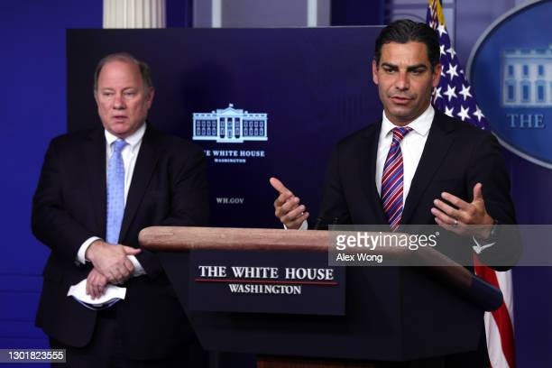 Miami, FL, Mayor Francis X. Suarez speaks as Detroit, MI, Mayor Mike Duggan looks on during a news briefing at the James Brady Press Briefing Room of...
