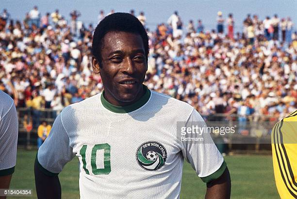 Head and shoulders portrait of the New York Cosmos soccer sensation Pele standing on the field in New York Cosmos uniform The crowd can be seen in...