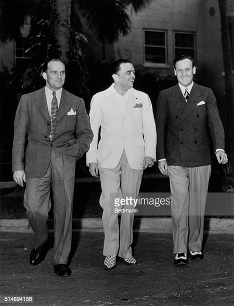 J Edgar Hoover combines business with pleasure on a recent trip to FL He is shown with two of his Aides Guy Hottell special agent of the Washington...