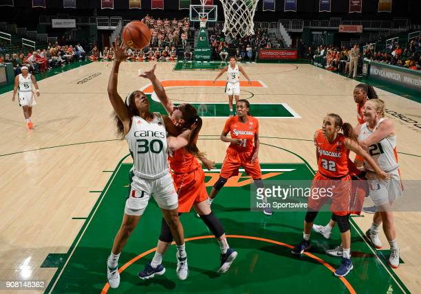 Miami forward/center Erykah Davenport shoots during a women's college basketball game between the Syracuse University Orange and the University of...