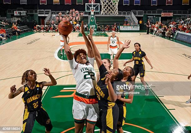 Miami forward/center Zada Williams shoots against Grambling forward Jazmine Torian during an NCAA basketball game between Grambling State University...