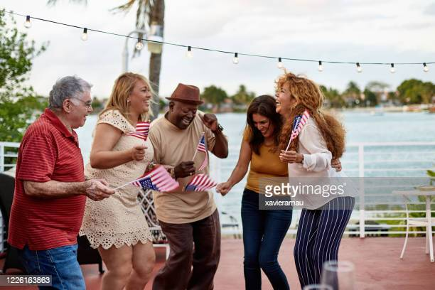 miami friends in 50s, 60s, and 70s dancing at outdoor party - celebration fl stock pictures, royalty-free photos & images