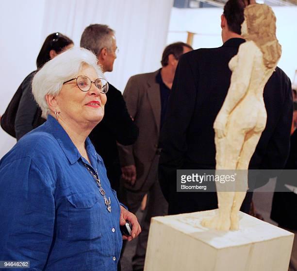 Miami gallery owner Barbara Gillman looks at Weiblicher Akt mit Maske 2006 by Stephen Balkenhol during Art Basel Miami Beach in Miami Florida...