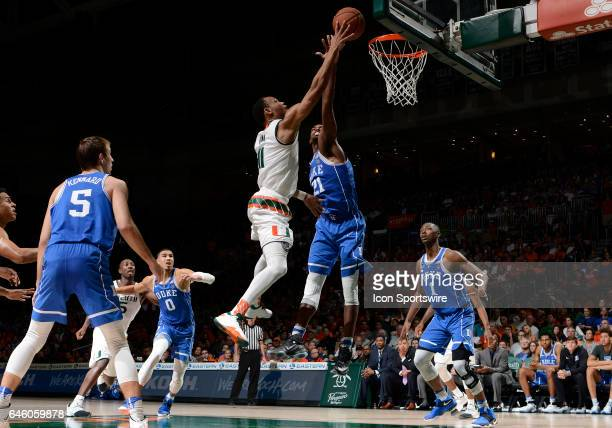 Miami guard Bruce Brown shoots against Duke forward Amile Jefferson during a college basketball game between the Duke University Blue Devils and the...