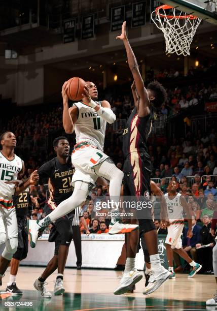 Miami guard Bruce Brown shoots against Florida State forward Jonathan Isaac during a college basketball game between the Florida State University...