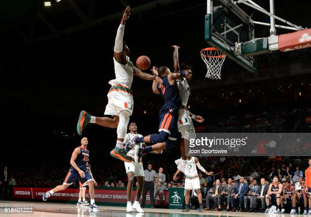 Miami guard Chris Lykes guard Lonnie Walker IV and Virginia guard Devon Hall pursue the ball during a college basketball game between the University...