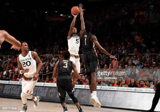 Miami guard Davon Reed shoots against Florida State forward Jonathan Isaac during a college basketball game between the Florida State University...