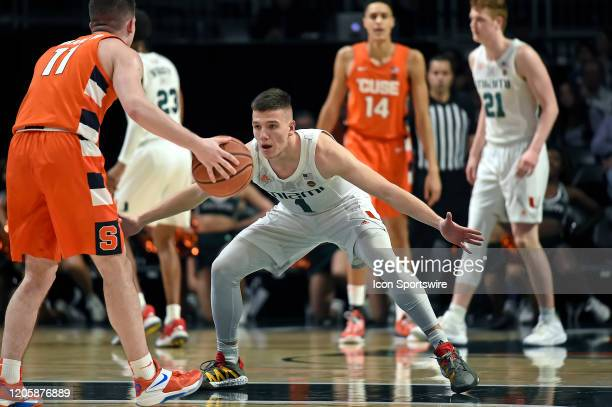 Miami guard Dejan Vasiljevic defends Syracuse guard Joseph Girard III in the second half as the University of Miami Hurricanes faced the Syracuse...