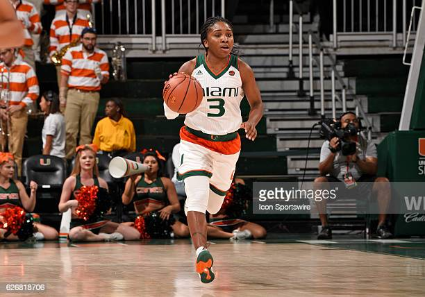 Miami guard Jessica Thomas dribbles during an NCAA basketball game between Grambling State University Tigers and the University of Miami Hurricanes...