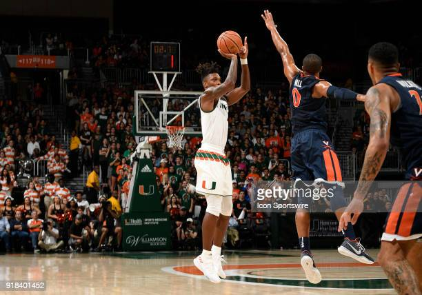 Miami guard Lonnie Walker IV shoots against Virginia guard Devon Hall during a college basketball game between the University of Virginia Cavaliers...