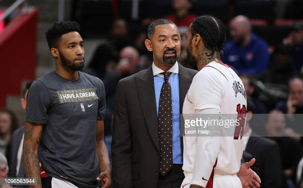 Miami Heat Assistant Coach Juwan Howard talk with James Johnson prior to the start of the game against the Detroit Pistons cat Little Caesars Arena...