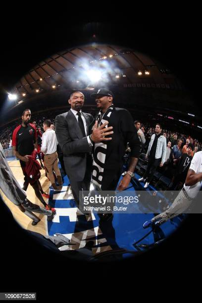 Miami Heat Assistant Coach Juwan Howard talks with Carmelo Anthony during the game between the Miami Heat and New York Knicks on January 27 2019 at...