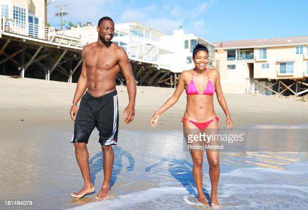 Miami Heat basketball player Dwyane Wade and actress Gabrielle Union are sighted enjoying a beach outing on September 21 2013 in Malibu California