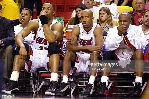 Miami Heat center Alonzo Mourning forward Bruce Bowen and guard Tim Hardaway watch the remaining few minutes of their game against the Charlotte...