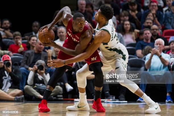 Miami Heat center Bam Adebayo looks for an open teammate as Milwaukee Bucks forward Giannis Antetokounmpo blocks in the fourth quarter on Sunday Jan...