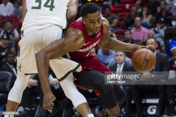 Miami Heat center Hassan Whiteside fights to get past the Milwaukee Bucks' Giannis Antetokounmpo on January 14 at the AmericanAirlines Arena in Miami