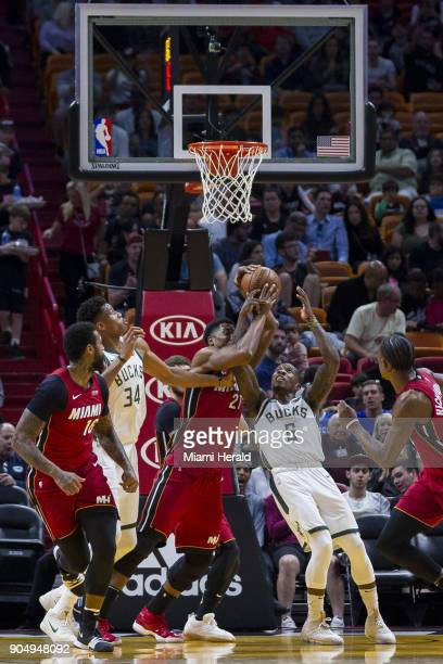 Miami Heat center Hassan Whiteside fights to get possession of the ball against Milwaukee Bucks' Eric Bledsoe in the first quarter on Sunday Jan 14...