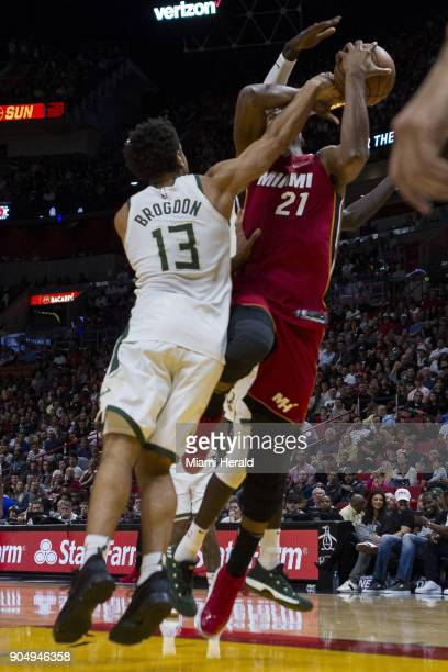 Miami Heat center Hassan Whiteside is fouled by Milwaukee Bucks Malcolm Brogdon in the second quarter on Sunday Jan 14 2018 at the AmericanAirlines...