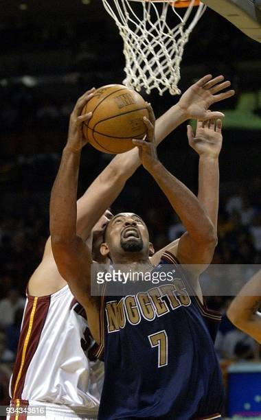 Miami Heat center Sean Marks blocks a shot by Denver Nuggets forward Juwan Howard during the fourth period 16 March 2002 at the American Airlines...