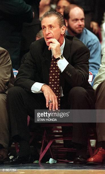 Miami Heat coach Pat Riley who usually stands throughout the game sits on the bench as he watches his team lose to the New York Knicks during the...