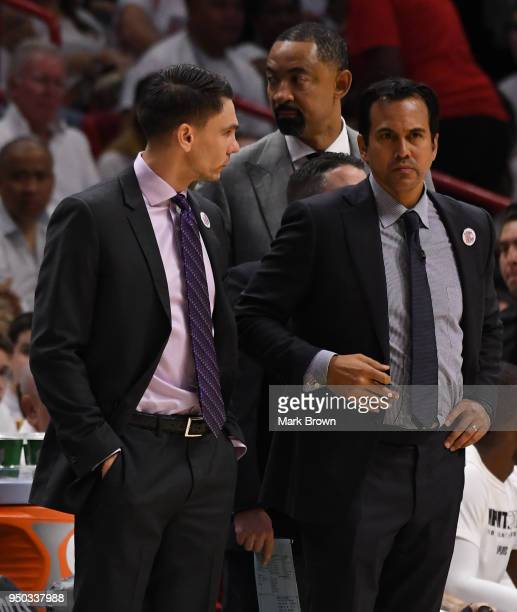 Miami Heat coaching staff Chris Quinn Head Coach Erik Spoelstra and assistant coach Juwan Howard in action in the first quarter against the...
